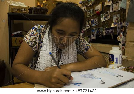 Thai Designer Women Drawing And Design Pattern Fashion On Paper For Make Mood Board And Cut Clothes