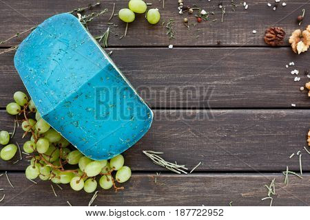 Cheese background. Gouda pesto blue lavender on rustic wood top view with copy space