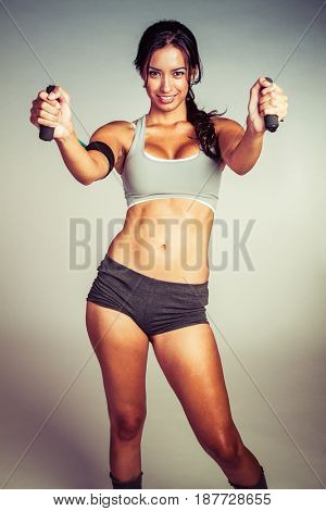 Beautiful hispanic exercise woman working out