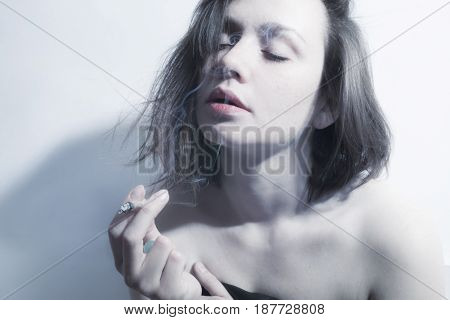 Young Beautiful Woman Smoking  Cigarette