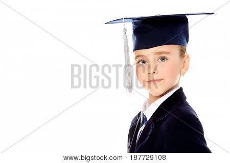 Portrait of a happy student girl in graduation cap. Isolated over white background. Educational concept. Copy space.