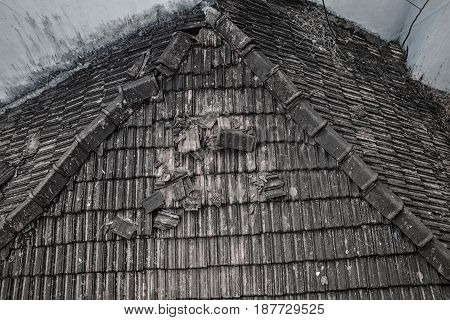 Ruined Tile Roof Of An Old Rural House