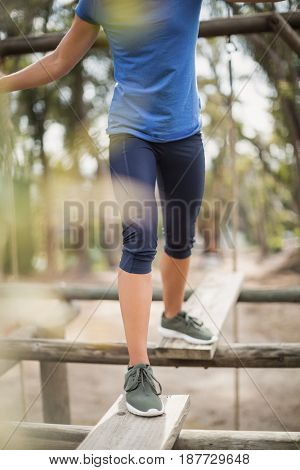 Fit woman during obstacle course training at boot camp