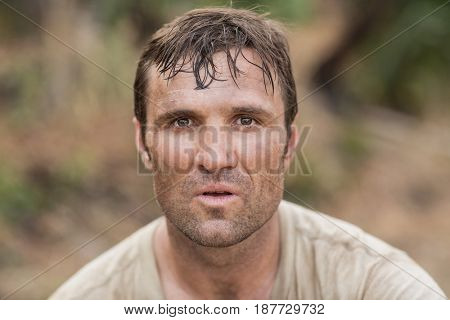 Portrait of fit man in boot camp