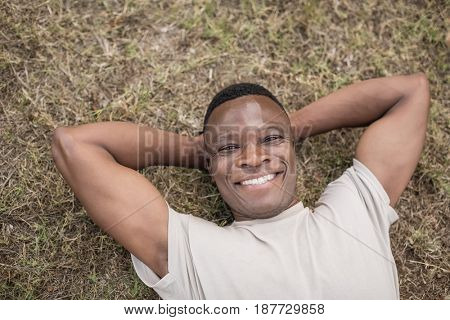 Portrait of happy military exercising in boot camp
