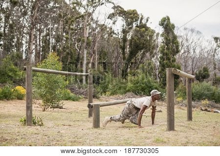 Military soldier training on fitness trail at boot camp