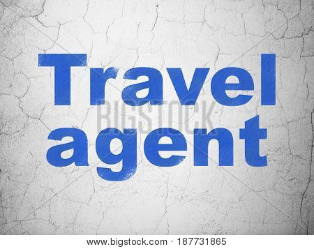 Tourism concept: Blue Travel Agent on textured concrete wall background