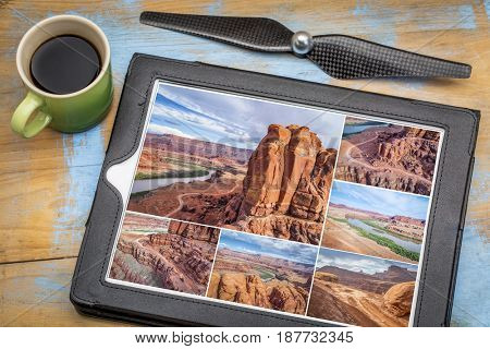 Colorado River canyon and 4wd trail at Chicken Corner in the Moab area, Utah - reviewing aerial pictures on a tablet with a cup of coffee, all screen images copyright by the photographer