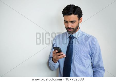 Businessman using mobile phone at conference centre