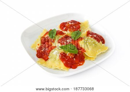 Ravioli with tomato sauce and basil isolated on white background