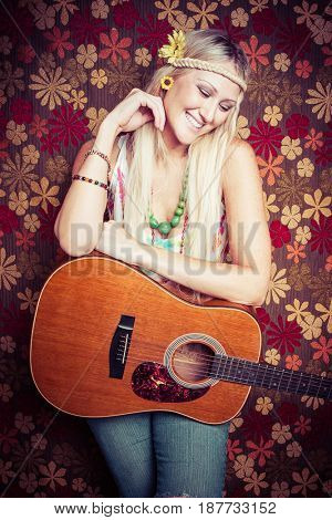 Beautiful smiling hippie guitar woman