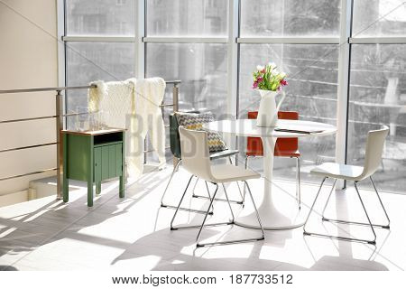Modern living room with table and chairs