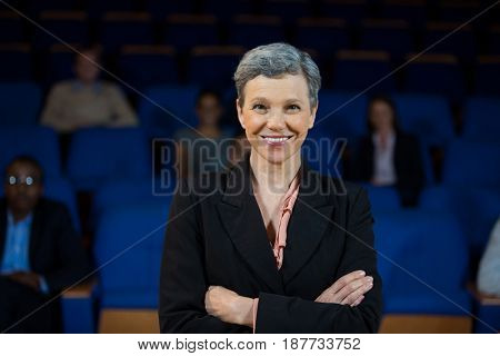 Portrait of female business executive with arms crossed at conference center