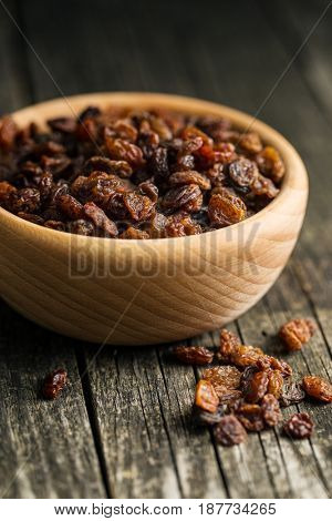 Sweet dried raisins in bowl.