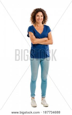 Smiling middle aged woman with arms folded, isolated on white background