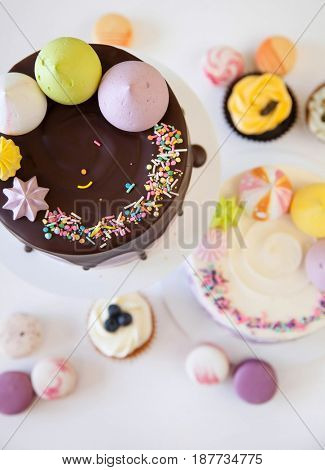 cute sweet cakes on white