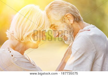 Old man and old woman in love in summer in the nature
