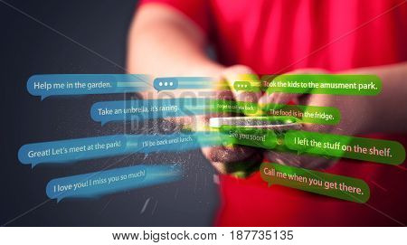Young man writing messages with smartphone application