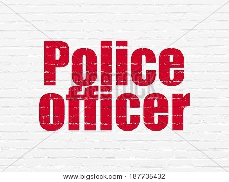 Law concept: Painted red text Police Officer on White Brick wall background