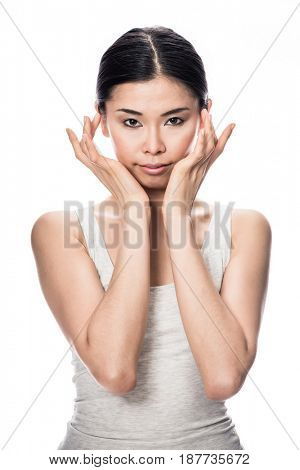 Portrait of Asian young woman looking at camera with an intelligent facial expression