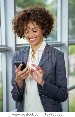 Businesswoman using mobile phone at conference centre