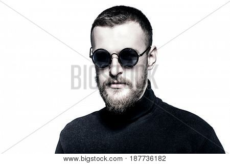 Handsome bearded hipster man wearing round sunglasses. Male fashion. Isolated over white.