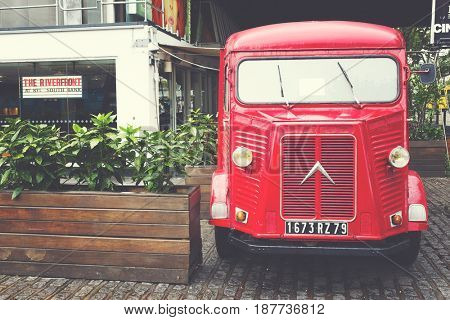 London, UK - 29 Sept 2016: Restored H-type Citroen delivery van parked on the South Bank of the Thames in London, UK. Mid 20th Century vintage vehicle with matte, retro filter applied..