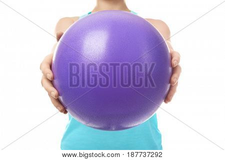 Woman with rubber ball on white background, closeup