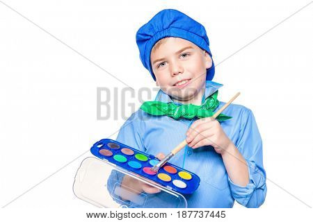 Different professions. Cute boy dressed in a costume of an artist holds brush and paints. Isolated over white.