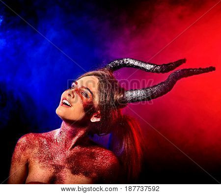 Mad satan woman on black magic ritual of in hell . Witch reincarnation mythical creature on Sabbath. Devil absorbing soul on Halloween. Mythical zodiac Horoscope Capricorn Aries , Taurus astrology.