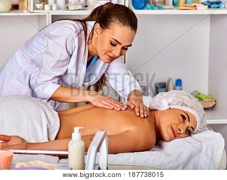 Massage room for therapy deals. Woman therapist making manual therapy back. Hands of masseuse treatment of spinal injuries 40 old mature client in spa salon. Two person in clinic.