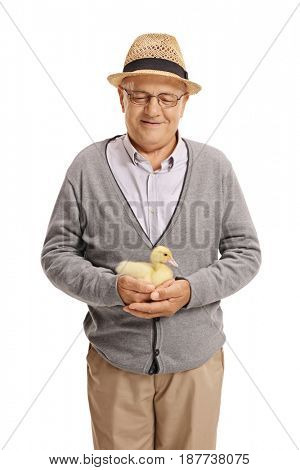 Elderly man holding a duckling isolated on white background