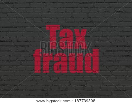 Law concept: Painted red text Tax Fraud on Black Brick wall background