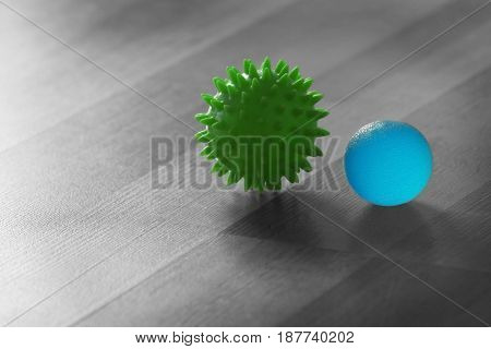 Two rubber balls on wooden background