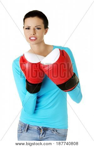 Portrait of a beautiful woman in boxing gloves