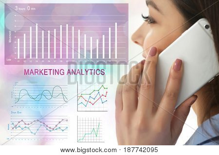 Marketing analytics concept. Woman talking on phone and diagrams on background