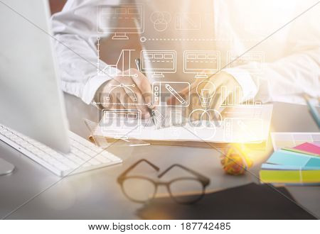 Designer concept.  Man working with draft at table, closeup