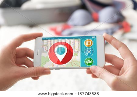 Modern technology and tourism concept. Woman using travel app on smartphone