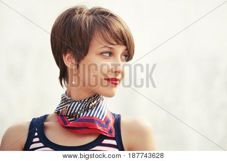 Happy young fashion woman walking outdoor. Stylish female model in tank top