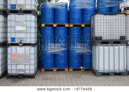 Blue oil drums and plastic container