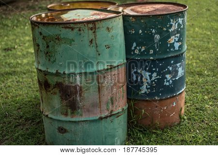 Metal old barrels isolated outdoor over green grass background