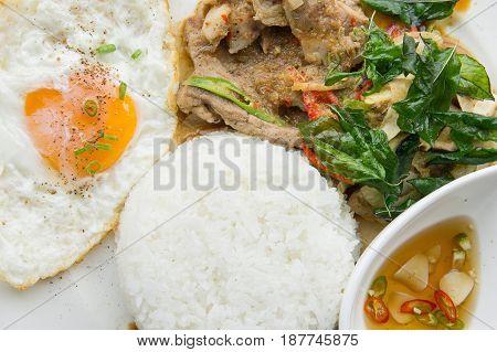 Grilled pork basil with Fried egg stir basil with crispy pork Kind of favarite Traditional Thai foods