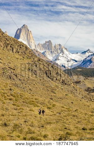 Two Men Walking At Trekking Road. El Chalten  - Argentina
