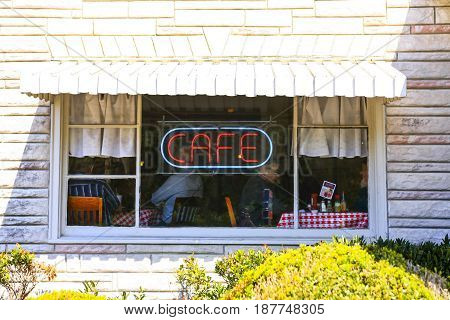 Nashville, TN, USA - 04/04/2016 Cafe window with a neon sign just outside Nashville TN on Hwy 100