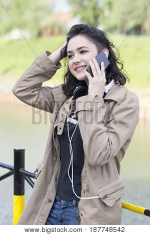 Young Smiling Woman, Hipster, Talking On Mobile Phone