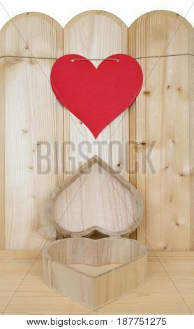 Heart of paper on a cord and a heart shaped present can