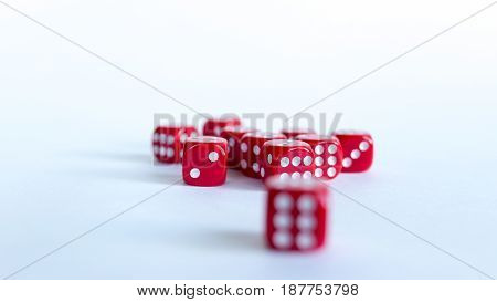 Red dices Close-up on a white background