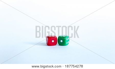 Green and red dices Close-up on a white background