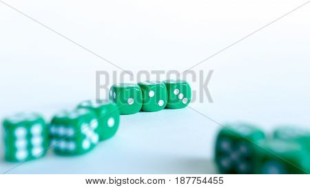 Green dices Close-up on a white background