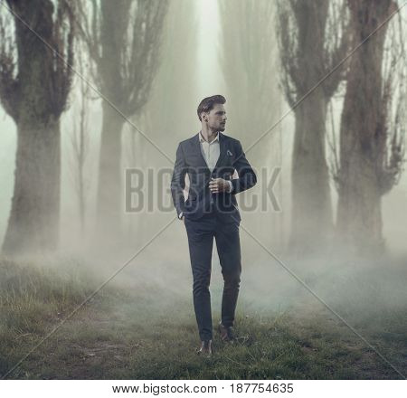 Young handsome businessman posing outside